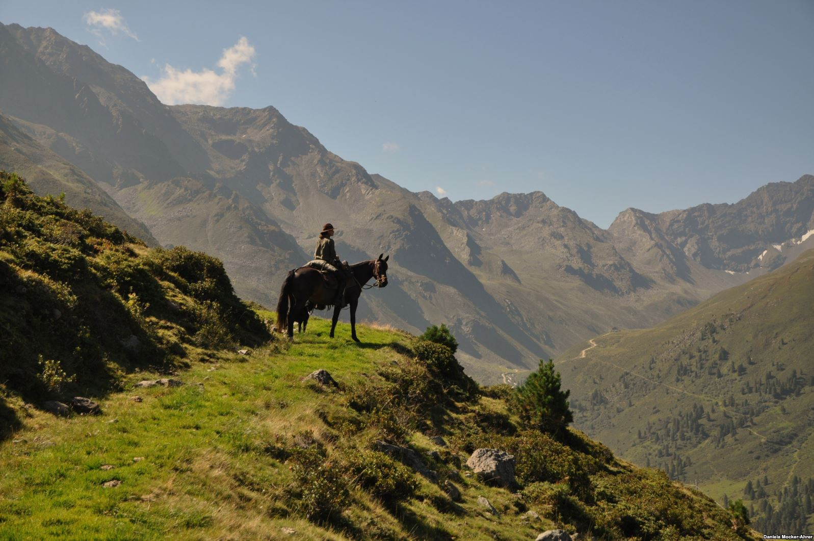 A rider with her Kabardian gelding Mashuk in the Austrian Alps in 2013